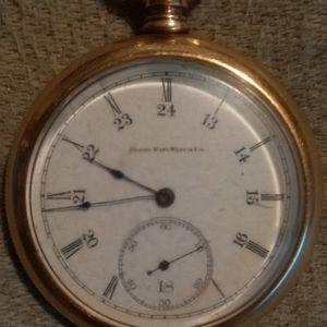 An Elgin pocket watch in a cashier case1896
